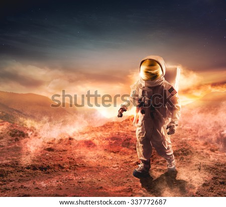 Astronaut walking on an unexplored planet - stock photo