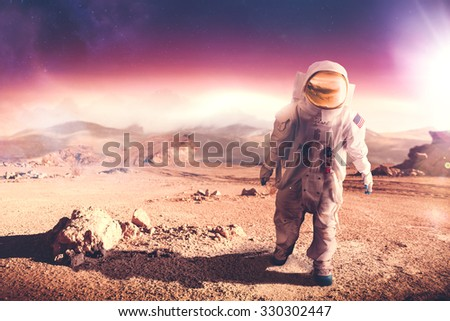 "Astronaut walking on an unexplored planet ""Elements of this image were NOT furnished by NASA"" - stock photo"
