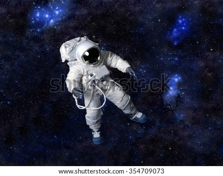 Astronaut wearing pressure suit against a space background.   - stock photo