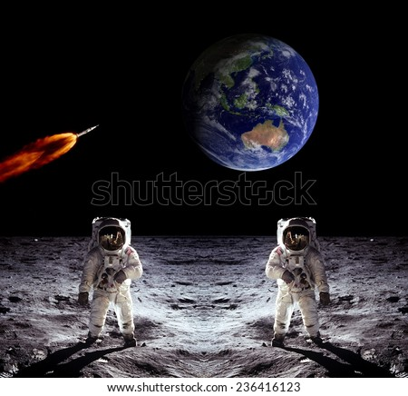 Astronauts Earth spaceman Moon space spaceship. Elements of this image furnished by NASA. - stock photo