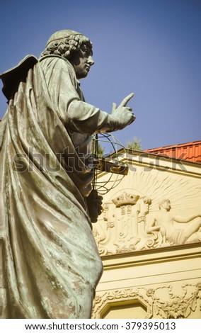 Astronomer Nicolaus Copernicus with astrolabe. Torun, Poland - stock photo