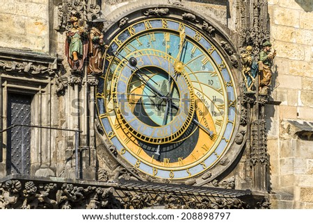 Astronomical Clock (Orloj) in the Old Town of Prague. Installed in 1410, it's the only one still working in the world. Czech Republic. Four figures flanking clock are set in motion at the hour. - stock photo