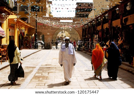 ASWAN - APRIL 28:Egyptian people walk in the market of Aswan city in Southern Egypt on April 28 2007.Aswan is one of the driest inhabited places in the world - stock photo