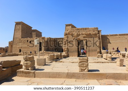 ASWAN, EGYPT - FEBRUARY 1, 2016: Tourists visiting the Graeco-Roman Temple of Philae  dedicated to the cult of Isis in Egypt - stock photo