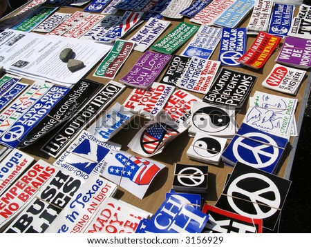 At an anti-war protest in Hollywood, California, on March 17, 2007, a selection of peace symbols and other bumper stickers are for sale. - stock photo