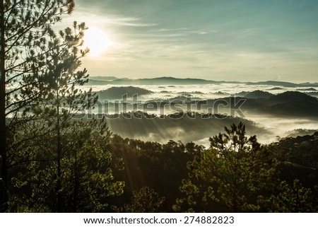 At dawn, sunrise, fog and rails on the hill. - stock photo