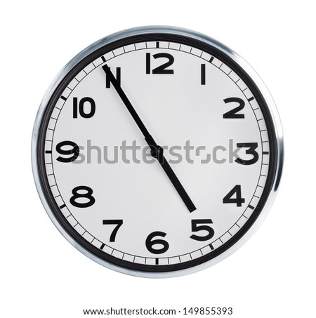 At five to five on the large wall clock - stock photo