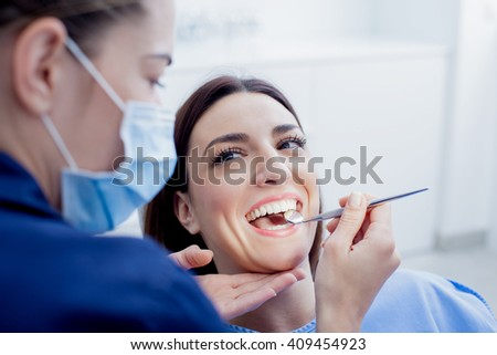 At the dentist. Female dentist in action. - stock photo