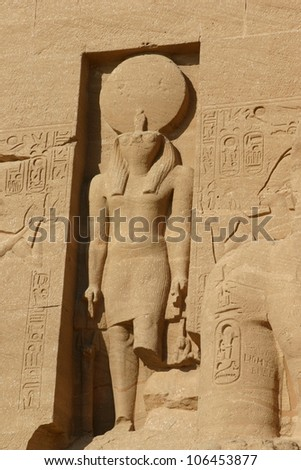 At the Egyptian temple at Edfu on the southern Nile river this statue of Ra, the sun god idol is carved from sandstone - stock photo