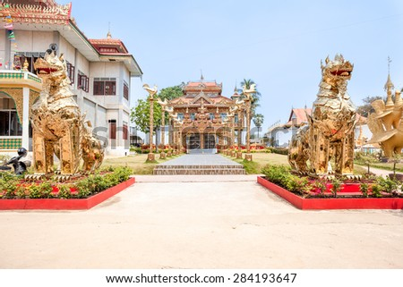 at the entrance of the temple there are two giant golden dragons - stock photo