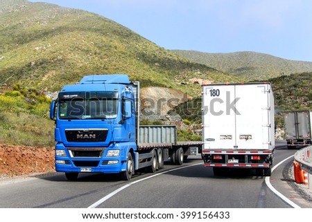 ATACAMA, CHILE - NOVEMBER 13, 2015: Modern blue truck MAN TGX at the mountainous interurban freeway. - stock photo