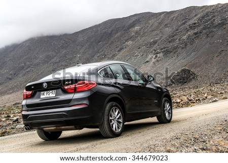 ATACAMA, CHILE - NOVEMBER 14, 2015: New black crossover BMW F26 X4 at the countryside. - stock photo
