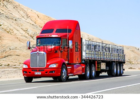 ATACAMA, CHILE - NOVEMBER 14, 2015: Red semi-trailer truck Kenworth T660 at the Pan-American Highway. - stock photo