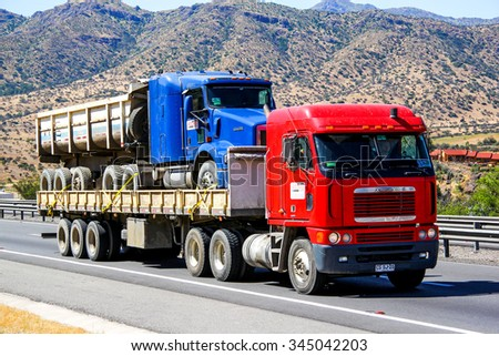 ATACAMA, CHILE - NOVEMBER 19, 2015: Semi-trailer truck Freightliner Argosy at the Pan-American Highway. - stock photo