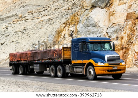 ATACAMA, CHILE - NOVEMBER 14, 2015: Semi-trailer truck Freightliner Columbia at the interurban road. - stock photo