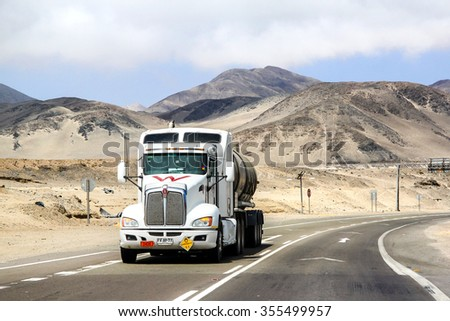 ATACAMA, CHILE - NOVEMBER 14, 2015: Semi-trailer truck Kenworth T660 at the interurban freeway through the Atacama desert. - stock photo