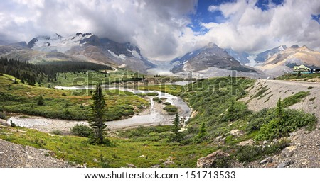 Athabasca Glacier and Columbia Ice Fields, Banff National Park, Alberta, Canada Located about an 1-1/2 hour drive north of Lake Louise. This is a glacier that is retreating due to Global Warming. - stock photo