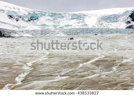 Athabasca Glacier with guided expedition to see the effect of global warming and climate change, Jasper National Park, Alberta, Canada - stock photo