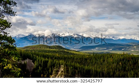 Athabasca River Valley in Jasper National Park with the Whistlers and Pyramid Mountains in the background - stock photo