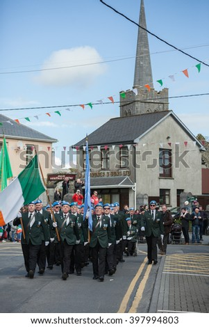 ATHENRY, IRELAND - MARCH 28: Members of Defence forces taking part in Parade during State ceremony marking the centenary of the 1916 Easter Rising on March 28, 2016 in Athenry, Ireland. - stock photo