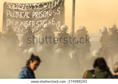 ATHENS, GREECE - APR 16, 2015: Leftist and anarchist groups seeking the abolition of new maximum security prisons, clashed with riot police, who responded with tear gas and stun grenades. - stock photo