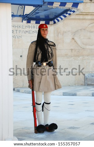 ATHENS, GREECE - AUGUST 6: Evzones sitting on guard in front of the Greek Parliament on August 6, 2013 in Athens, Greece.  - stock photo