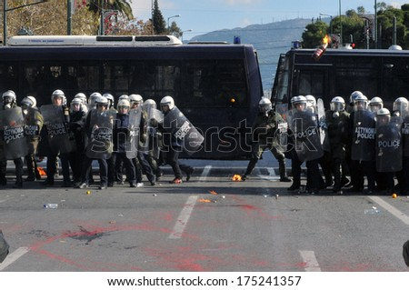 ATHENS, GREECE- DEC. 12 Molotov bomb being thrown to riot police during demonstration, in front of Greek parliament, in Athens, December 10, 2008. - stock photo