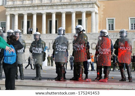 ATHENS, GREECE-DEC. 12. Riot police covered in red paint. , during demonstration against austerity measures, in front of Greek parliament, in Athens, December 22, 2008. - stock photo