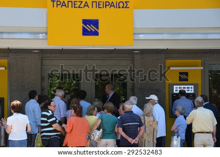 ATHENS, GREECE - JULY 1, 2015: Bank workers assist crowd of people waiting to withdraw part of their pension. Some banks were open to the public today only for pensioners without ATM cards. - stock photo