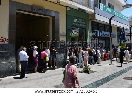 ATHENS, GREECE - JULY 1, 2015: Long queue of people waiting for money at ATM cashpoint. Banks are closed and capital controls allow cash withdrawal of 60 euro per day. Greek financial crisis. - stock photo