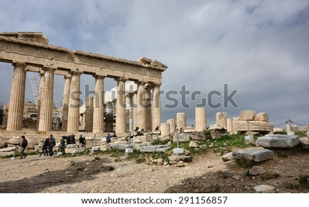 ATHENS, GREECE - MARCH 23, 2015: people under the Parthenon ancient temple on the Athenian Acropolis - stock photo