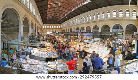 ATHENS, GREECE - MAY 05: Fish Market in Athens on MAY 05, 2015. Seafood Stalls with Fishmongers and Shoppers in Central Market in Athens, Greece. - stock photo