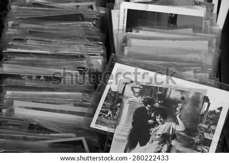 ATHENS, GREECE - MAY 21, 2015: Old photos and vintage postcard prints for sale at flea market. Black and white. - stock photo