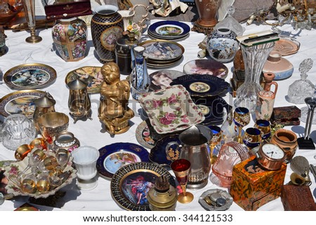 ATHENS, GREECE - MAY 31, 2015: Vintage glass decorative objects antique porcelain plates and vases for sale at flea market. - stock photo
