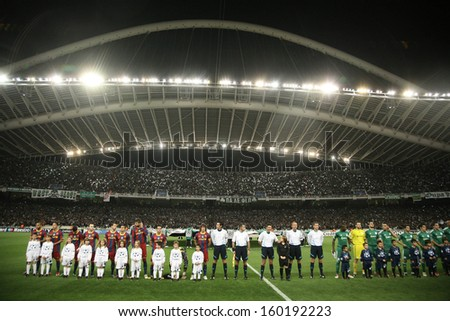 ATHENS, GREECE - NOV 24 : Front view of the teams during the Champions League Anthem before the UEFA Champions League group stage match Panathinaikos vs Barcelona on November 24, 2010  Athens, Greece - stock photo