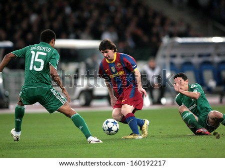 ATHENS, GREECE - NOV 24 : Gilberto of Panathinaikos (L) in action with Messi of Barcelona (R) during the UEFA Champions League match Panathinaikos vs Barcelona on November 24, 2010 in Athens, Greece - stock photo