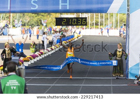 ATHENS,GREECE-NOV 9:32nd Athens Classic Marathon a hard race of 42,195 m. Felix Kipchirchir Kandie crosses the line to win at the Panathenean stadium ,November 9, 2014 in Athens,Greece  - stock photo