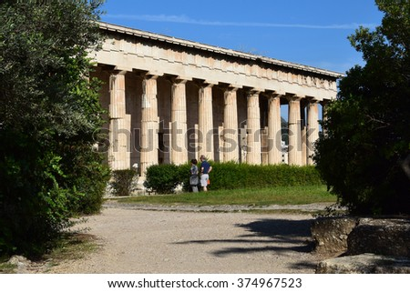 ATHENS, GREECE - OCTOBER 14, 2015: People visiting temple of hephaestus ruins at the ancient agora of Athens, Greece. - stock photo