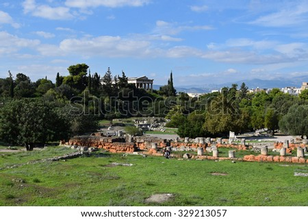 ATHENS, GREECE - OCTOBER 14, 2015: People visiting the ancient agora archaeological site and the ruins of the temple of hephaestus. - stock photo