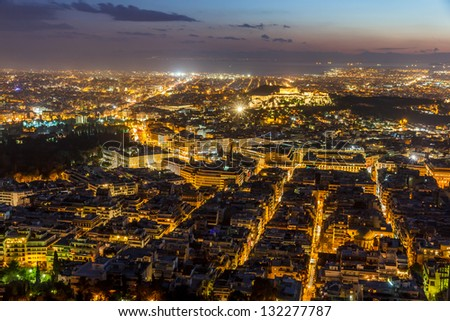 Athens skyline aerial view in the afternoon with the lights over blue hour, Syntagma, Greek Parliament and Parthenon are visible - stock photo