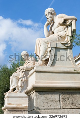 Athens - The statue of Plato  in front of National Academy building by the Italian sculptor Piccarelli (from 19. cent.) and the Athena statue on the background. - stock photo