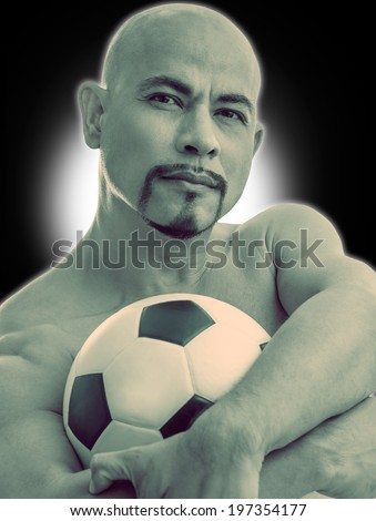 athlet smart man muscle footballer seriously with football ,	have beard ,on white and black background looking camera,looking like hardy , stalwart , tough - stock photo