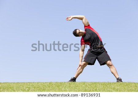 Athlete at the city  park warming and stretching - stock photo