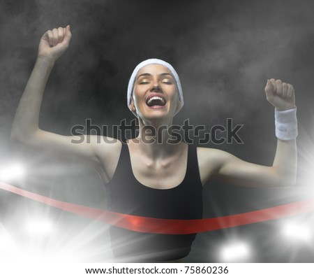 Athlete celebrates victory - stock photo