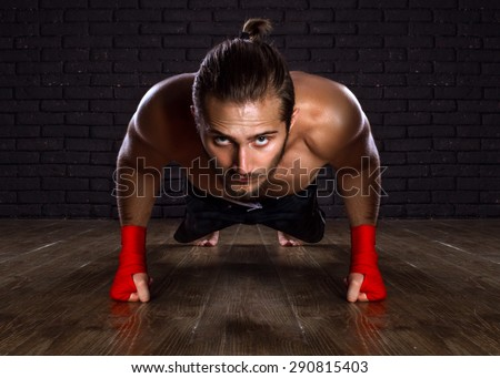 Athlete Doing Push-ups Exercise On The Floor - stock photo