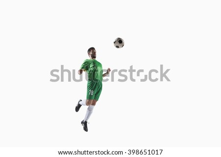 Athlete heading soccer ball - stock photo