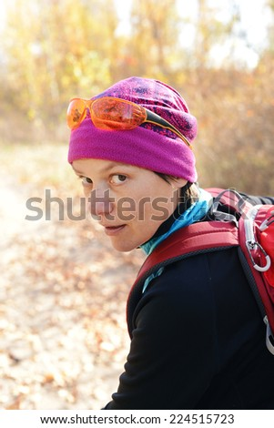 Athlete in a sunny autumn forest - stock photo