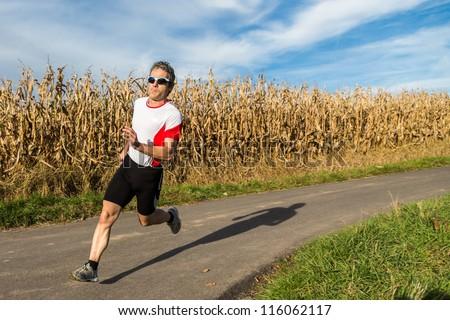 athlete is jogging - stock photo