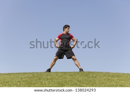 Athlete male at the city park - stock photo