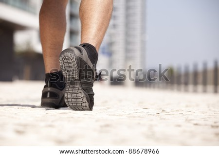 Athlete man shoes running in the city (selective focus) - stock photo